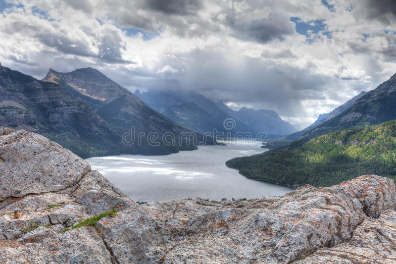 Canada-Waterton-Glacier-National-Park. This image was captured on a very dark, windy, and cold day, from high above the lake. There were spectacular storm clouds stock image