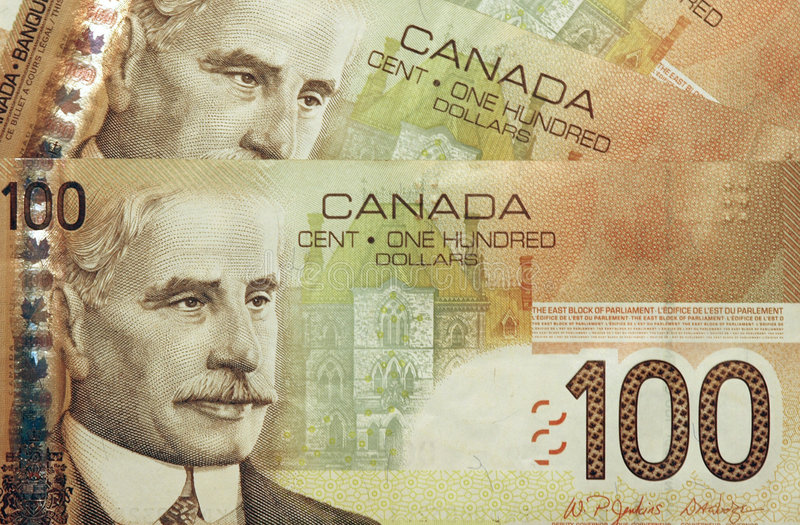 Canadian 100 dollar bills stock images