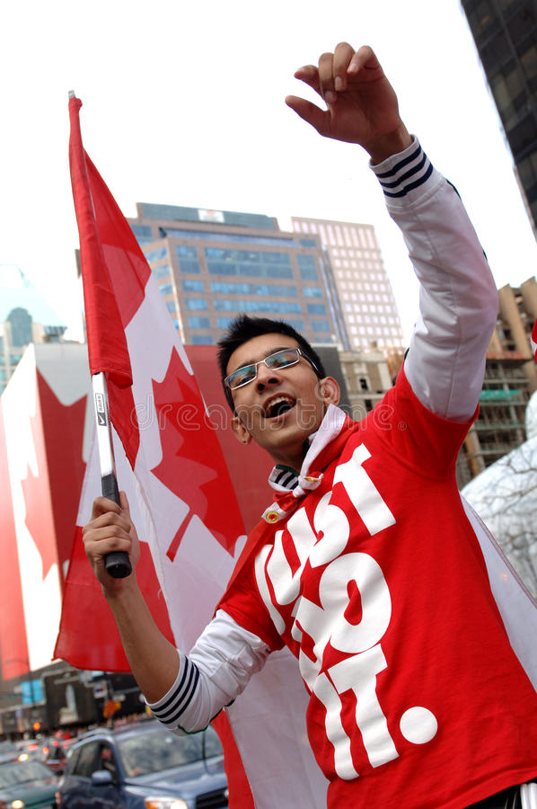 Download Canadian editorial stock photo. Image of flag, 2010, hands - 13255223