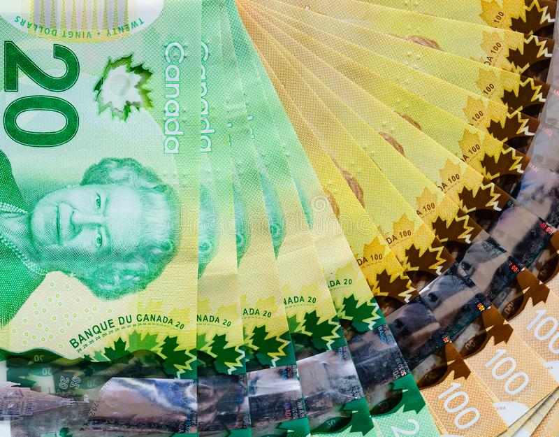 Canadian banknotes background. Of twenty and hundred dollar bills for business and financial concept stock photography