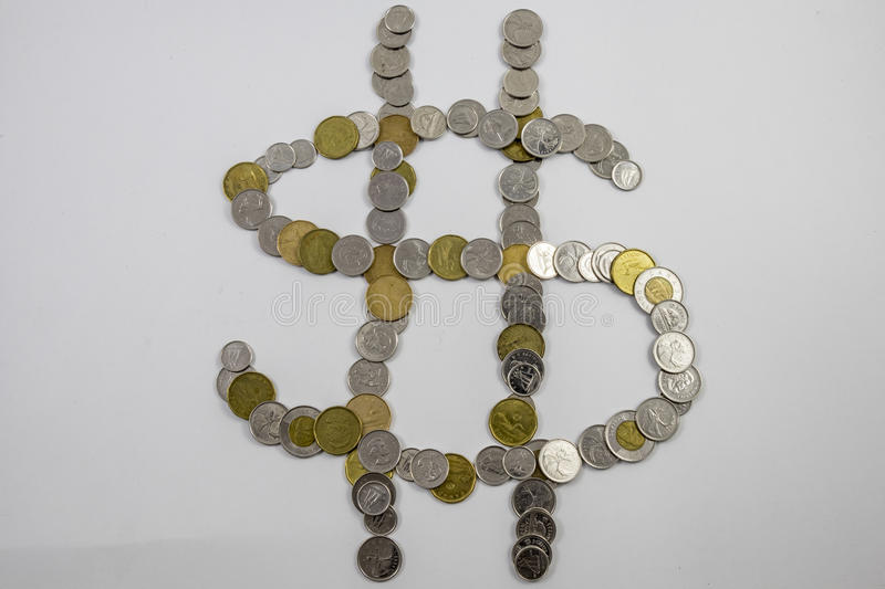 Canadian Change arranged in the shape of a money sign angled. Change arranged in the shape of a money sign CDN stock photos