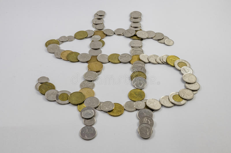Canadian Change arranged in the shape of a money sign angled. Change arranged in the shape of a money sign CDN stock images