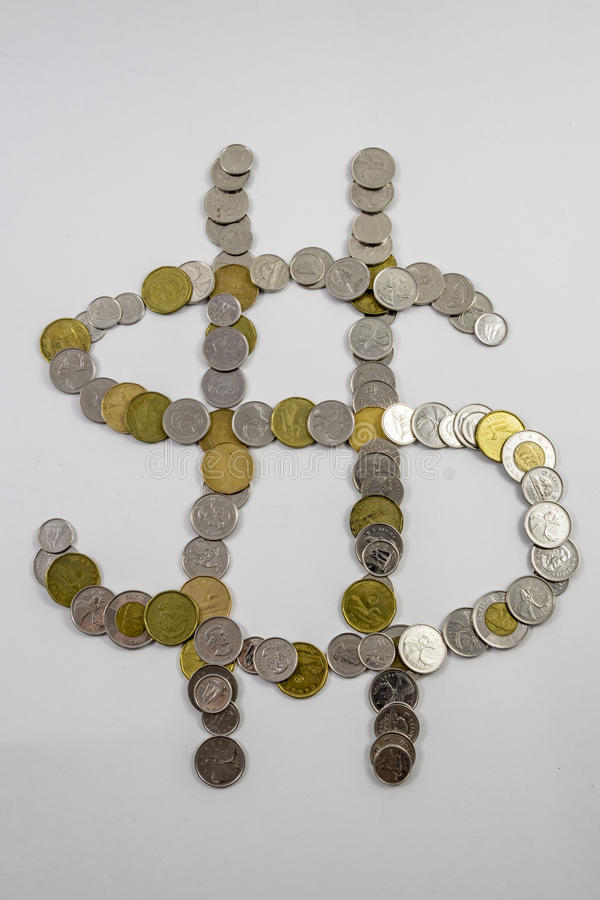 Canadian Change arranged in the shape of a money sign. Change arranged in the shape of a money sign CDN royalty free stock photo
