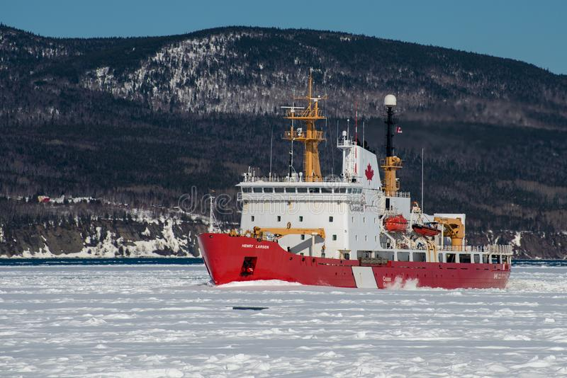 Canadian Coast Guard icebreaker Henry Larsen at work in the Gaspe Bay. Gaspe, Quebec, Canada on March 30, 2018 stock images