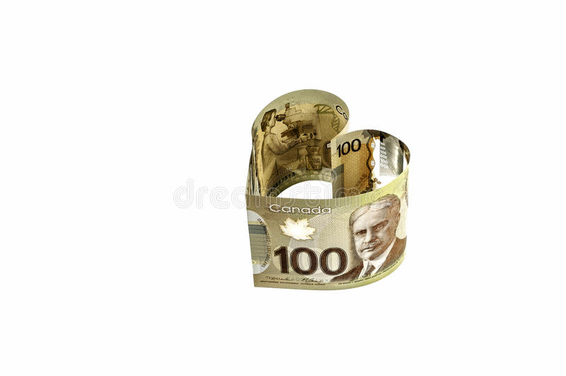 100 Canadian dollar banknote. Isolated, heart-shaped, close up view of new 100 Canadian dollar banknote royalty free stock image