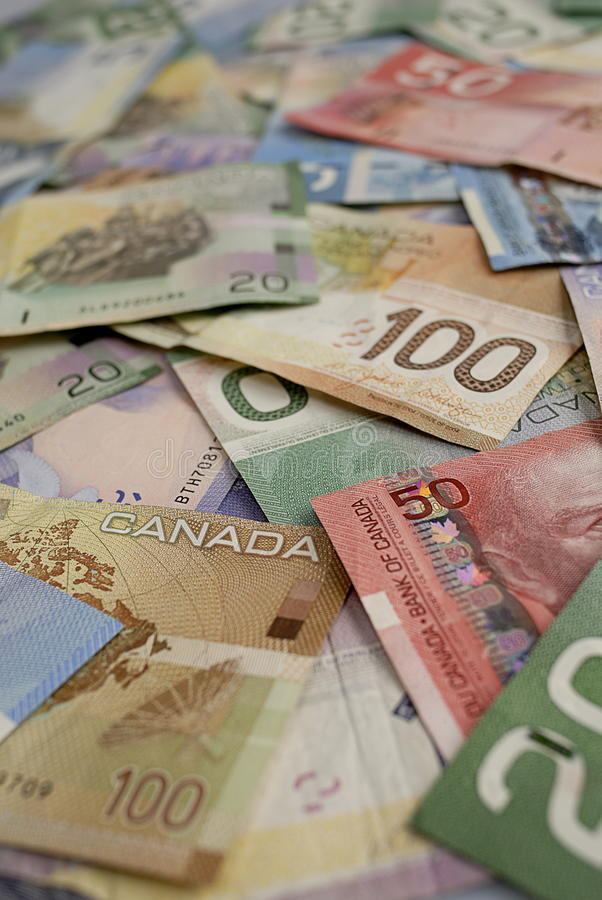 Canadian Dollar Bills. A still life of a pile of Canadian cash. $5, $10, $20, $50 and $100 denominations stock photo