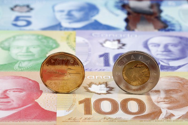 Canadian Dollar coins on the background of banknotes. From Canada royalty free stock image