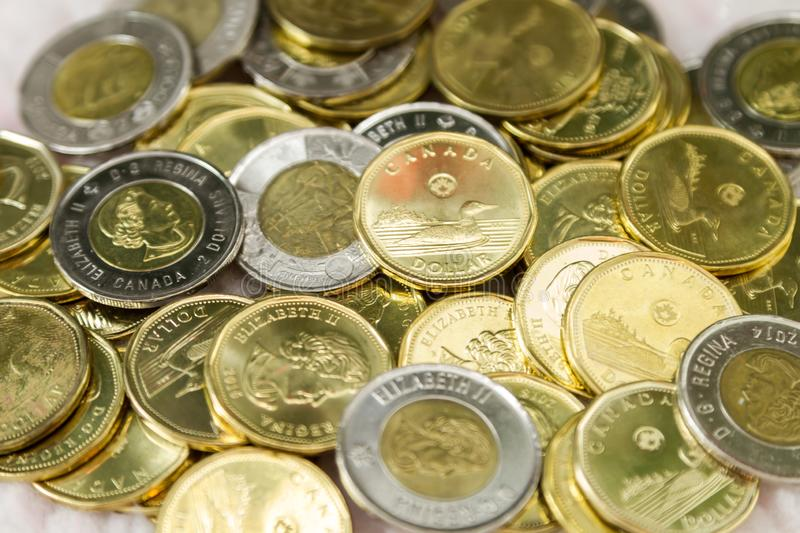 Canadian $1 dollar coins or loonie and $2 dollar coins or toonie. Canadian $1 and $2 dollar coins. The Canadian one dollar coin, commonly called the loonie. It stock images