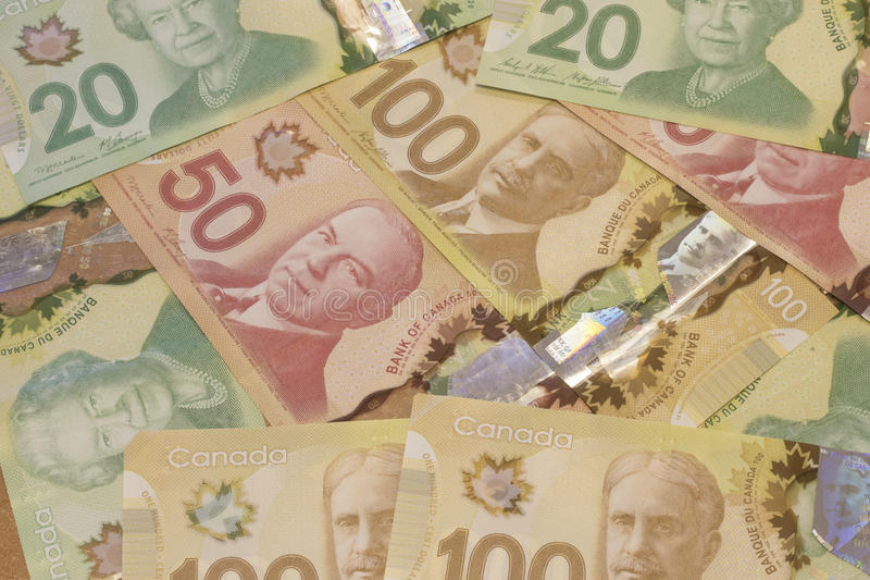 Canadian Dollar Currency/Bills. Canadian Currency/Bills sit on a table in dominanations of $20 (Twenty), $50 (Fifty), and $100 (one hundred royalty free stock image