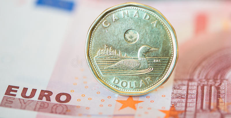 Canadian Dollar or Loonie Continues to Fall Amid Weak Oil Prices. The Canadian dollar or loonie continue to drop compared to other currencies due to the low oil royalty free stock images