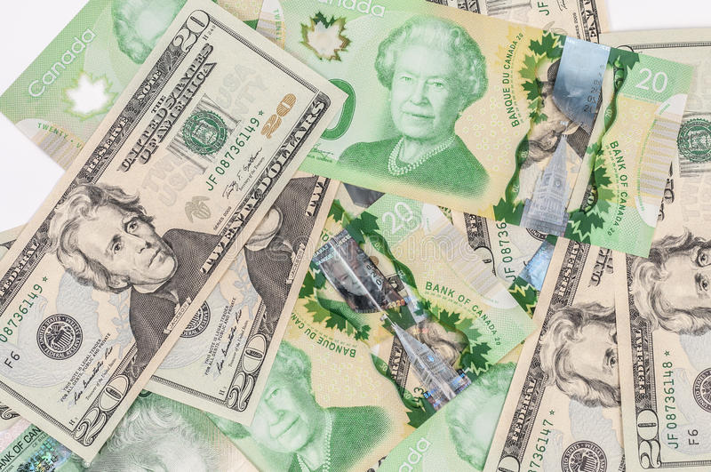 Canadian dollar at par with US dollar. Mixture of canadian and US dollar bills stock photography