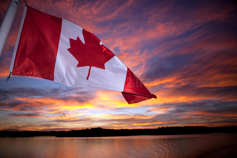 Canadian Flag stock photo. Image of water, canada, sunset ...