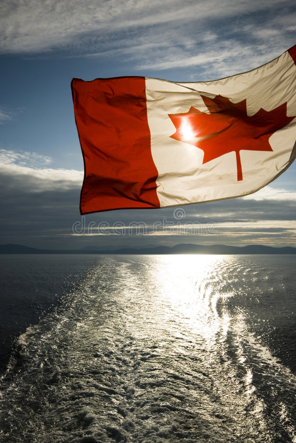 Canadian Flag. Canadian Ffag flying from a ferry on its way back from Vancouver Island royalty free stock photography