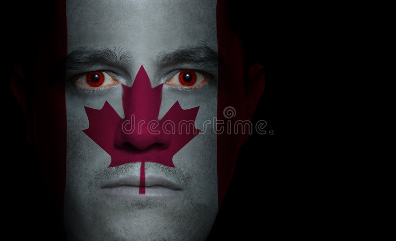 Canadian Flag - Male Face royalty free stock photo