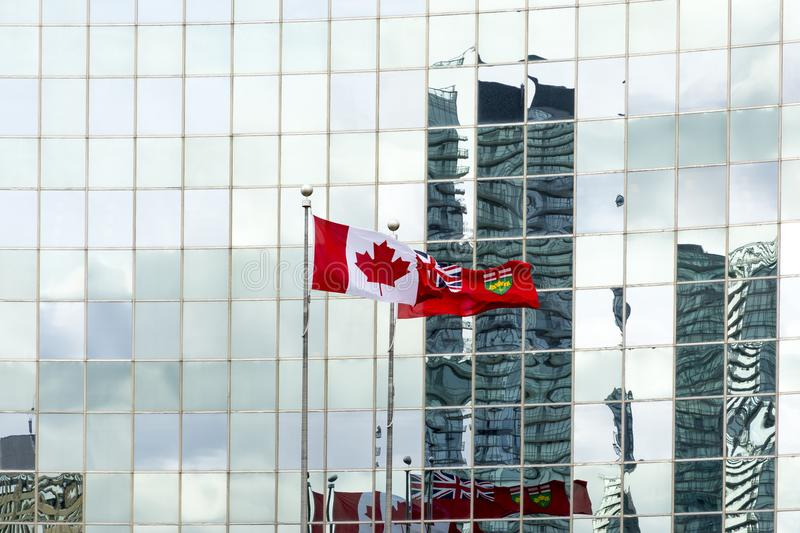 Canadian flag. Toronto,Canada-august 3,2015:Canadian flag on skyscrapers background stock photo