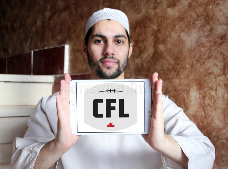 Canadian Football League, CFL logo. Logo of Canadian Football League, CFL on samsung tablet holded by arab muslim man. CFL is a professional sports league in stock photo