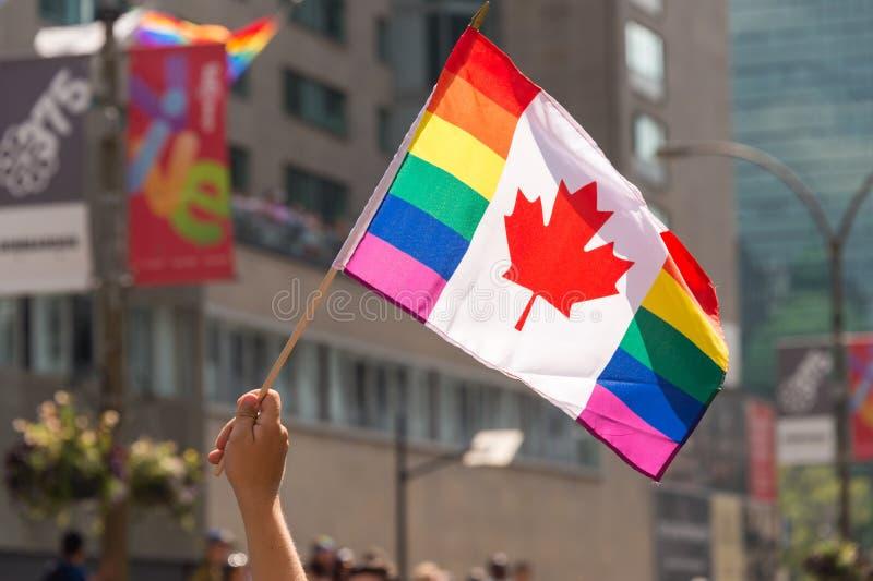 Canadian Gay rainbow flag at Montreal gay pride parade. Montreal, CANADA - 20 August 2017: Canadian Gay rainbow flag at Montreal gay pride parade royalty free stock image