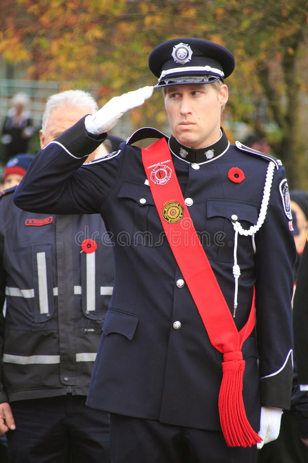 Canadian Honour Guard. A member of Canada s Honour Guard salutes during Remembrance Day ceremonies in Abbotsford, BC on November 11, 2013 stock photography