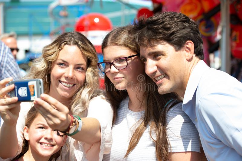 Canadian Prime Minister Justin Trudeau with girls. Canadian Liberal Leader and Prime Minister Justin Trudeau smiles as a group of girls takes a photo with him stock photo