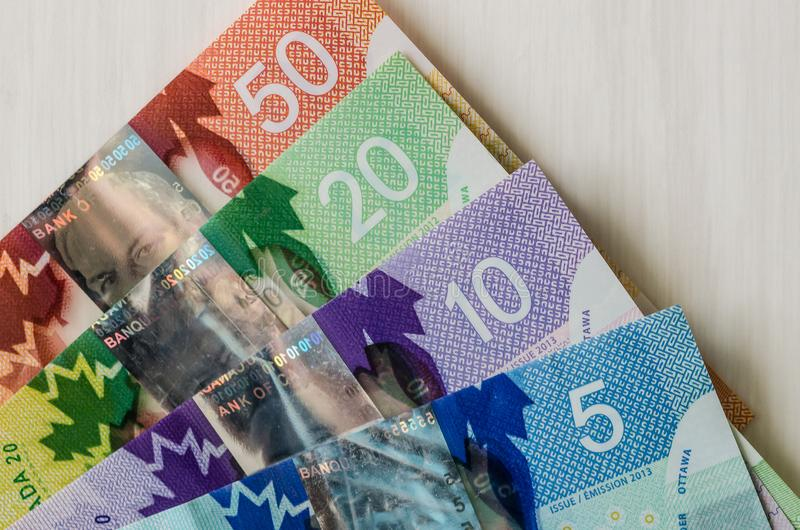 Canadian money. Dollar banknotes on wooden background.  royalty free stock photo