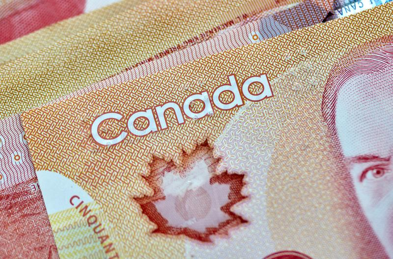 Canadian money in a pocket of a blue jeans. Banknotes background dollar canada currency business cash finance symbol bills paper dollars savings red abstract royalty free stock photos