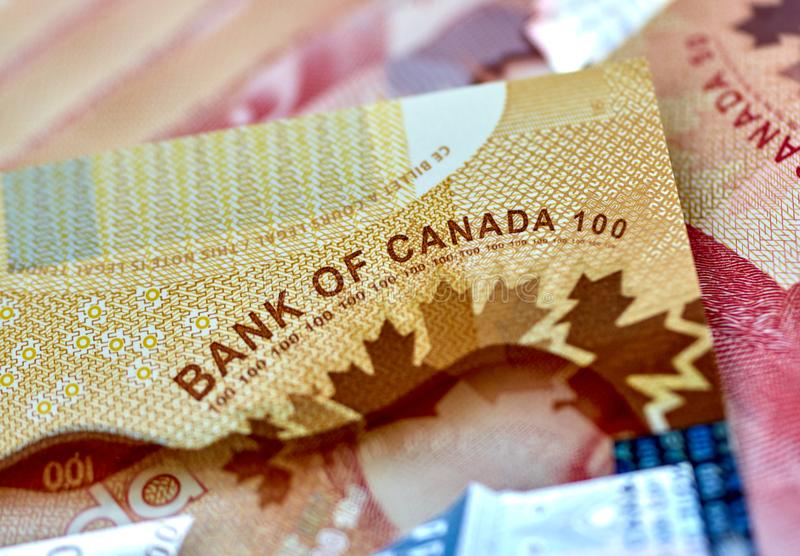 Canadian money in a pocket of a blue jeans. Banknotes background dollar canada currency business cash finance symbol bills paper dollars savings red abstract royalty free stock images