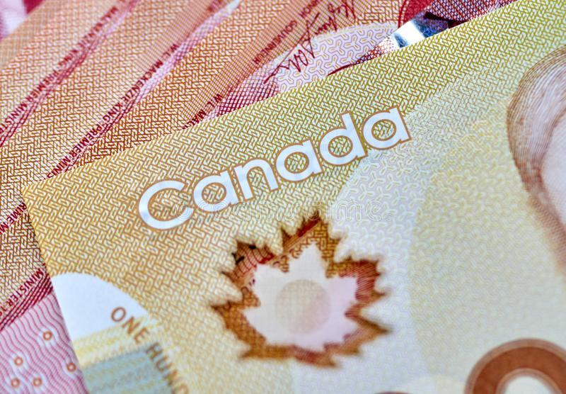 Canadian money in a pocket of a blue jeans. Banknotes background dollar canada currency business cash finance symbol bills paper dollars savings red abstract royalty free stock photo