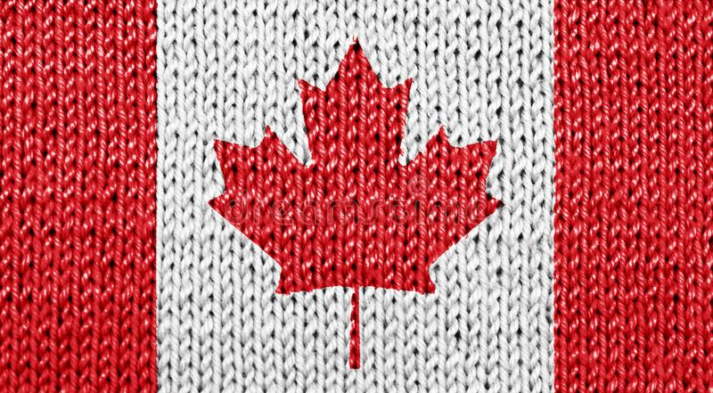 Canadian national flag on knitted background stock photography