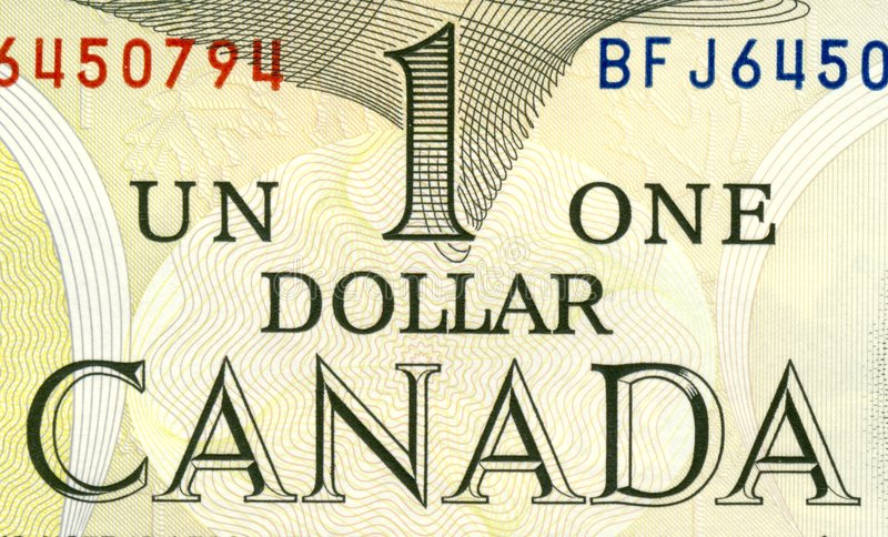 Canadian one dollar. Fraction of old Canadian one dollar bill stock photography