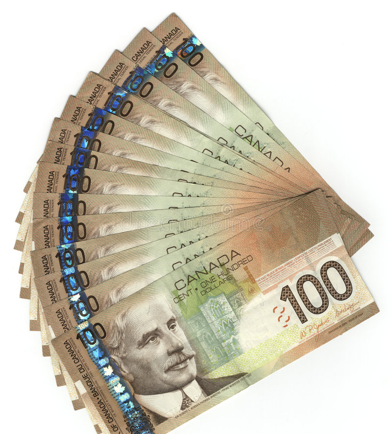 Canadian one hundred dollar bills. Fanned out Canadian one hundred dollar bills royalty free stock photo