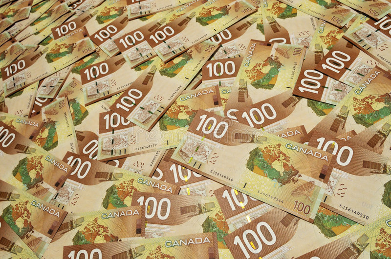 Canadian one hundred dollar bills. Background stock photos