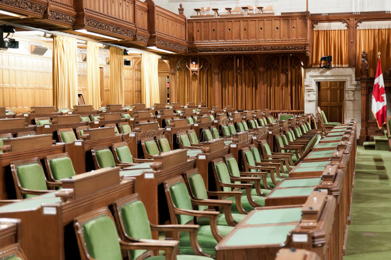 Canadian Parliament: the House of Commons. The House of Commons of the Canadian Parliament in Ottawa, Canada. The view on the row of chairs and desks for the royalty free stock images