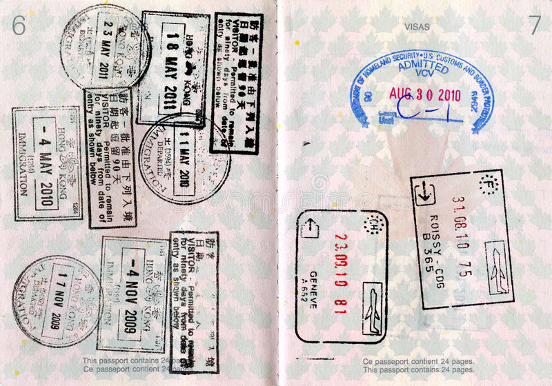 Canadian Passport with Stamps. Canadian Passport with entry stamps to Hong Kong, France, Geneva and the United States stock images