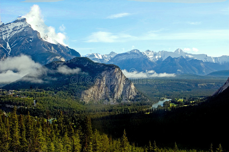 Canadian Rockies over Banff. Banff valley surrounded by mountains of the Canadian Rockies stock image