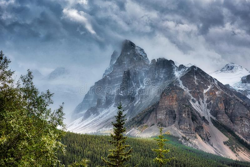 Canadian Rockies snowing. Dramatic shot of a snow storm in the Canadian Rockies royalty free stock images