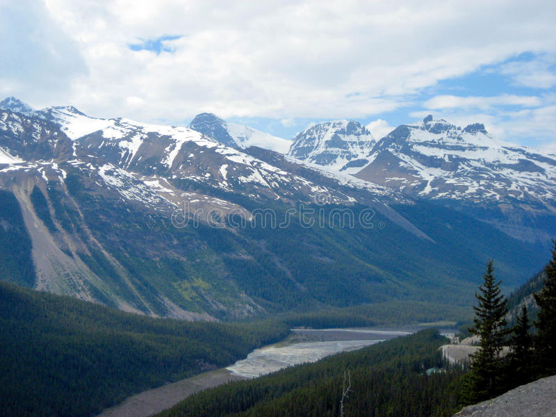 Canadian Rockies Valley. A river flows with cold alpine snow melt runoff in Banff National Park stock image