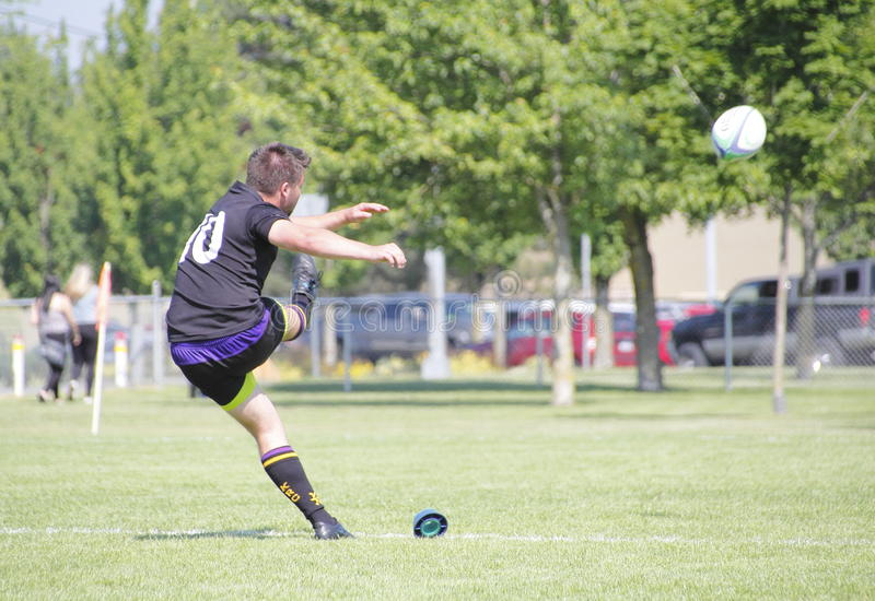 Canadian Rugby Regional Championship. A rugby player kicks a field goal in regional rugby championship competition royalty free stock image