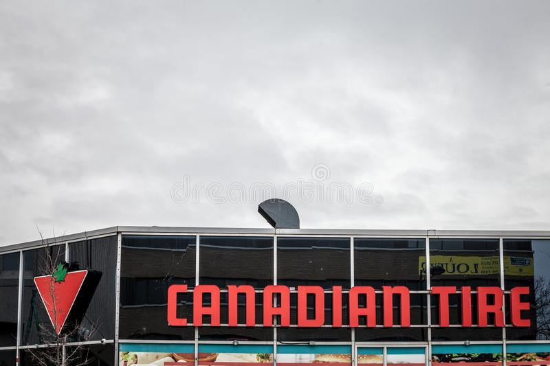 Canadian Tire logo in front of one of their stores in Montreal, Quebec. stock image