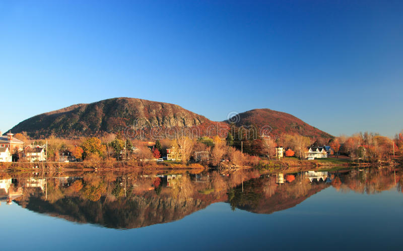 Canadian UNESCO biosphere reserve. Mirror view of the Mont Saint-Hilaire's mountain and town. The mountain was designated by the UNESCO as the first Canadian stock photography