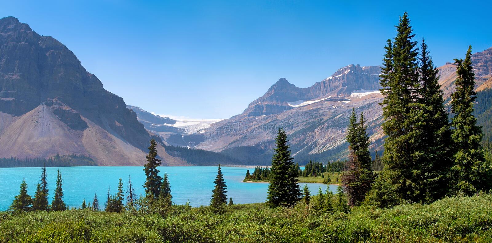 Canadian wilderness in Banff National Park, Canada. Scenic nature landscape with Rocky Mountains in the background as seen at Bow Lake, Banff National Park stock photos