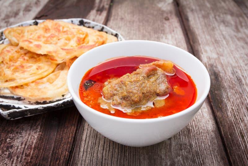 Canai di Roti con curry piccante fotografia stock libera da diritti