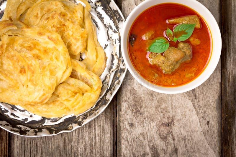 Canai di Roti con curry piccante immagini stock