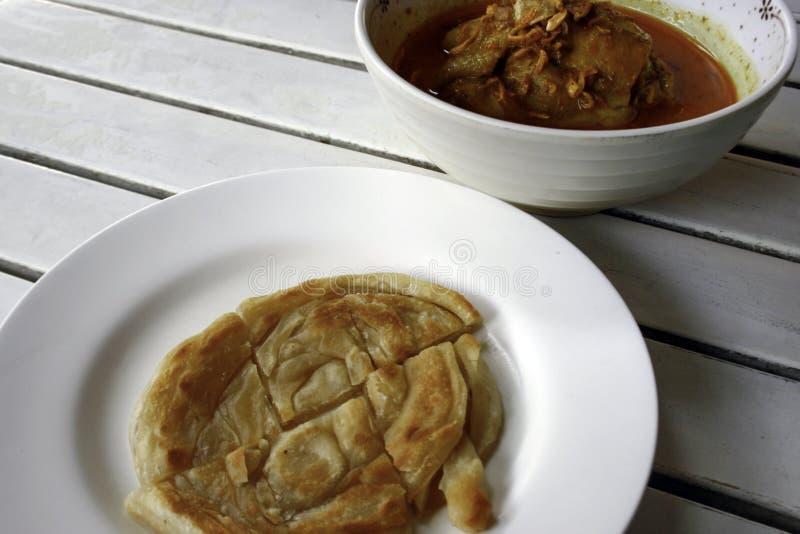 Canai di Roti con curry piccante immagini stock libere da diritti
