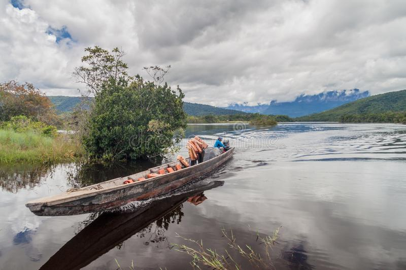 CANAIMA, VENEZUELA - AUGUST 16, 2015: Canoe on the river Carrao, Venezuela. It is used for tours to Angel Falls, the stock photos