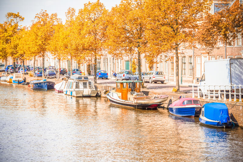 Canal in Amsterdam during the autumn. View of a canal in Amsterdam during the autumn stock photos