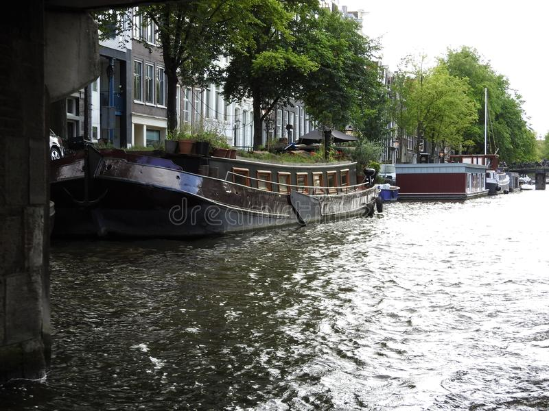 Canal in Amsterdam Netherlands houses the Amstel river landmark old European city summer landscape royalty free stock photography