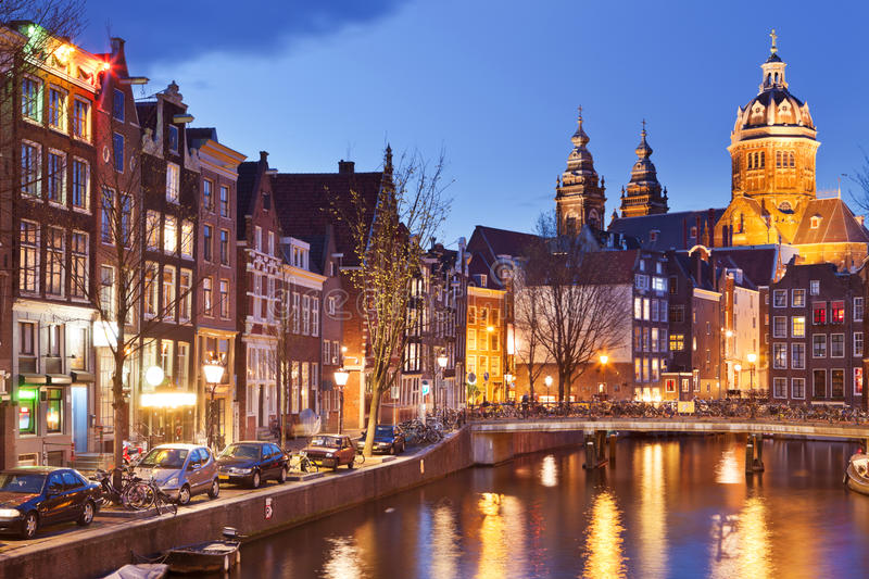 Canal in Amsterdam, The Netherlands by night stock photo
