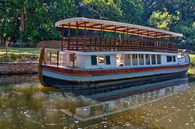 Canal barge on historic C&O Canal waterway. A working replica canal barge on the C&O Canal National Park waterway at Great Falls, MD stock photo