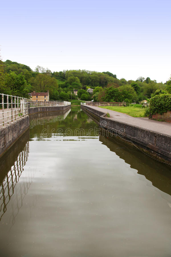 Download Canal Boat Entering Lock With Trees, Reflection, C Stock Image - Image: 31864781