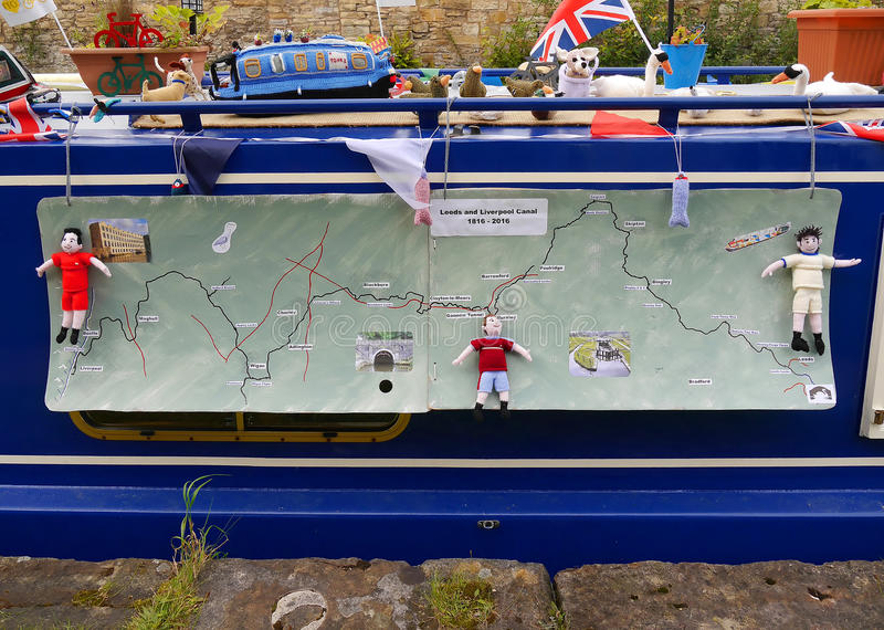 Canal Boat with fabric map at the 200 year celebration of the Leeds Liverpool Canal at Burnley Lancashire. The Leeds and Liverpool Canal is a canal in Northern stock images